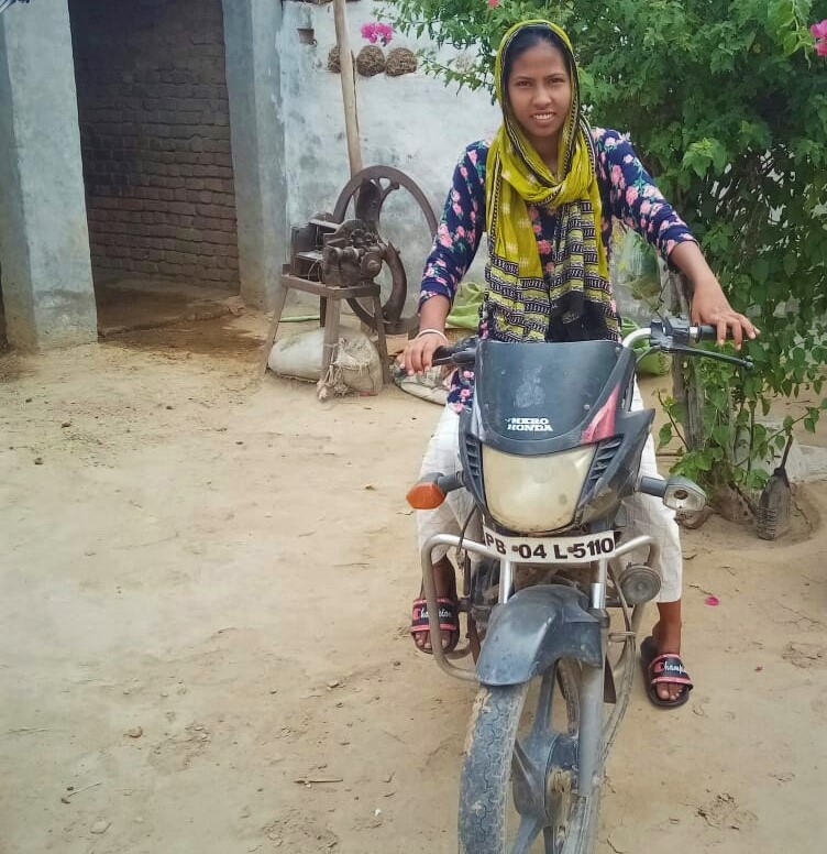 Tania on her brother's bike 2